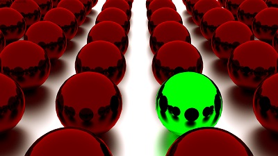 Rows of red spheres with one green sphere